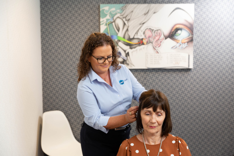 audiologist at Hear Check helping woman tinnitus