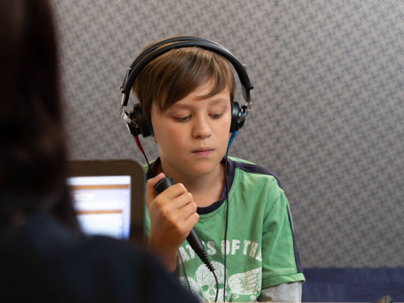 boy doing hearing test at audiologist