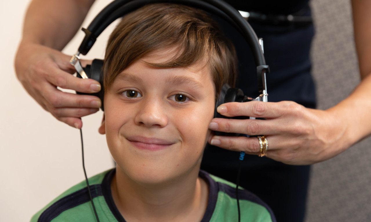 boy with headphones on getting hearing test