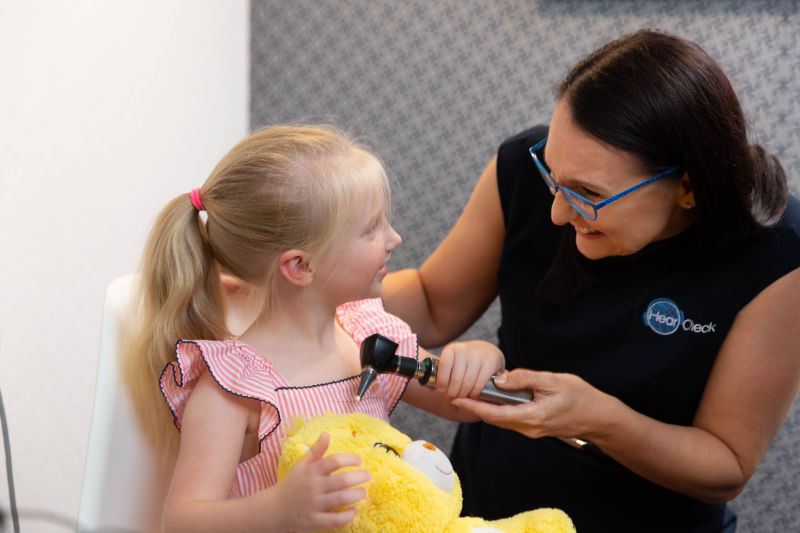 child enjoying playing with audiologist