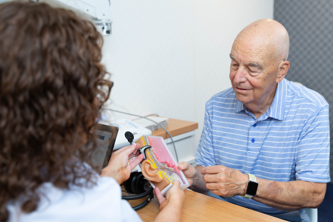 pensioner with audiologist hearing services