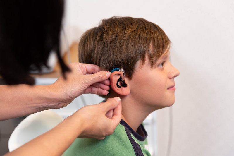 child with hearing aid getting fitted