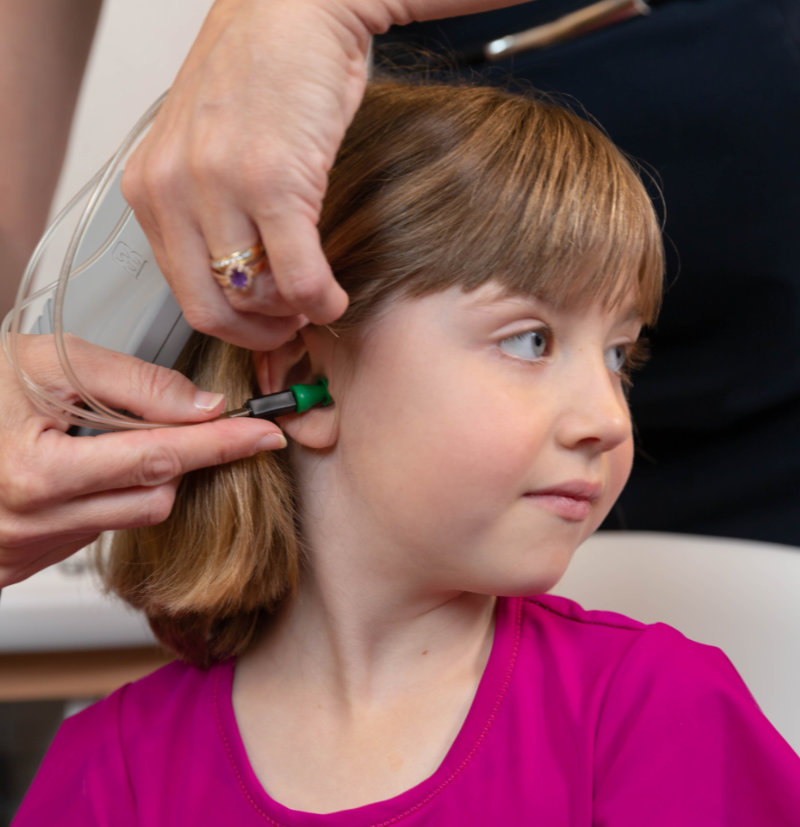 child with hearing loss during hearing test