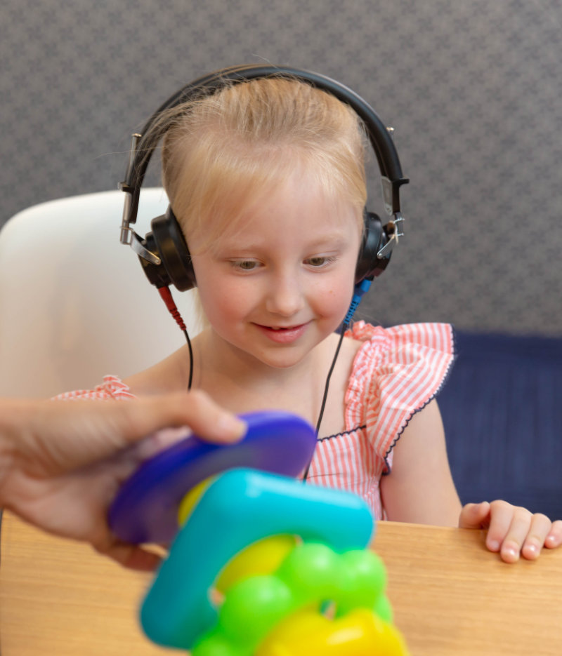 child with hearing loss has hearing test